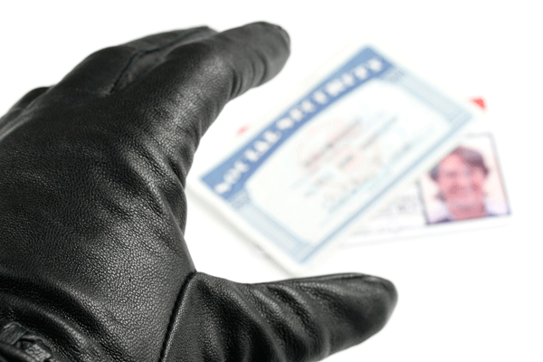 theft-glovedHandReaching-iStock_000006030247-600w.png